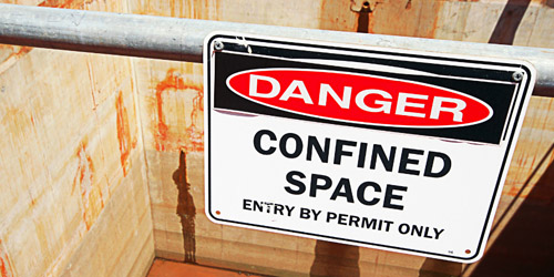 A confined spaces warning sign